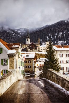 The ski resort town of Savognin tucked into the Swiss Alps near Davos and St. Moritz is a popular destination for Swiss residents and international tourists.